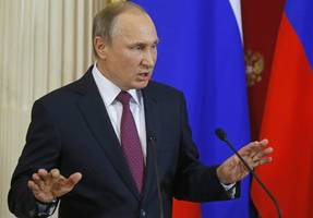 the latest: putin deplores us sanctions on russia
