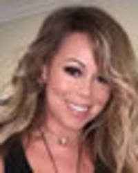 mariah carey teases intimate flash as fans cry 'put some pants on'