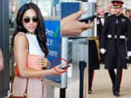 Harry puts ring on Meghan Markle seen wearing thumb ring