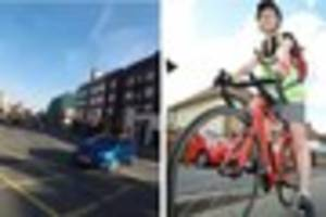 WATCH Near miss as taxi pulls out in front of a cyclist in...