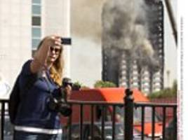Disrespectful tourists selfies charred Grenfell Tower