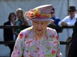 the queen is a vision in a colourful floral dress