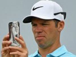 paul casey has a picture of his wife on his phone cover