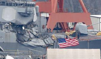 us destroyer nearly sunk after deadly collision; bodies of seven us sailors found