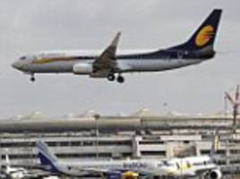 woman gives birth to boy on flight to india at 35,000ft
