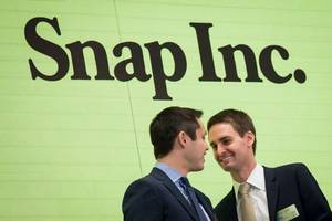 snap signs $100 million partnership with time warner for shows and ads