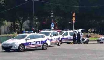major police operation on champs elysees in paris after car rams police van, armed driver arrested