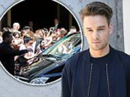 Liam Payne is mobbed by fans at Milan Men's Fashion Week