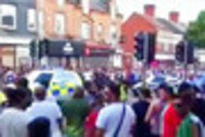 six police officers injured as cricket fans clash after...