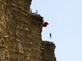 base-jumpers leap off broadchurch cliff in dorset