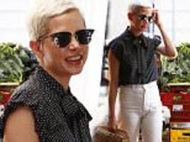 Michelle Williams dons chic polkadot blouse while in Rome