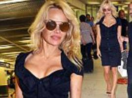 Pamela Anderson makes stylish arrival at airport in Paris