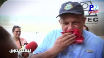 costa rica's president luis guillermo solís swallows wasp.