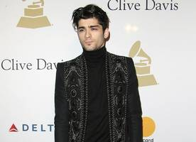 zayn malik recalls being detained in airport during first visit to u.s. with one direction