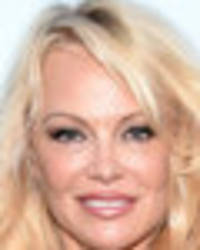 Pamela Anderson brings boobs out of retirement with topless exposé