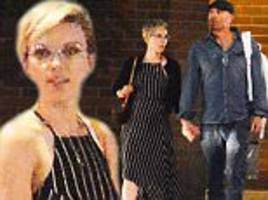 Scarlett Johansson holds hands with mystery man