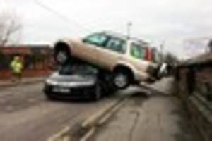 man fined nearly £300 after car crashes and ends up on top...