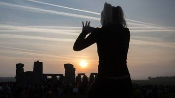 In Pictures: Stonehenge crowds celebrate summer solstice