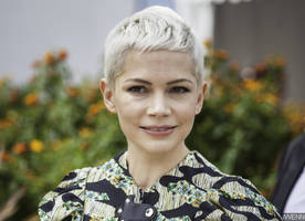 new romance? michelle williams is all smiles when spotted with this mystery man in rome