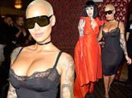 Amber Rose pours her curves into skintight lace dress