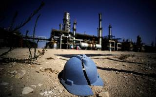 Oil prices slump to seven-month low