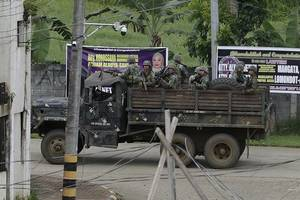Rebels attack Philippine village, possibly to divert troops