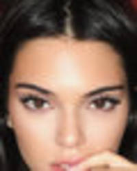 Kendall Jenner strips to tiny leopard print knickers