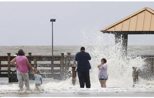 tropical storm cindy: boy killed when wave washes up log
