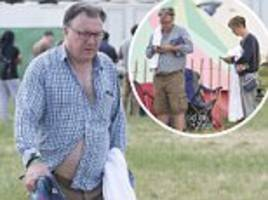 ed balls and yvette cooper queue for shower at glastonbury