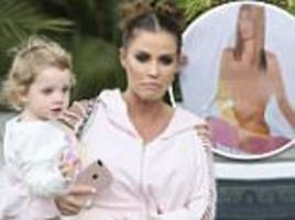 Katie Price shows daughter a TOPLESS picture of herself