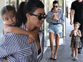 kourtney kardashian gives penelope a piggyback ride in la
