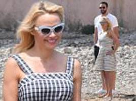 Pamela Anderson and Adil Ramy spend day at beach in France