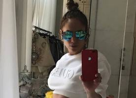 Jennifer Lopez Claps Back at Haters for Accusing Her of Photoshopping Her Abs