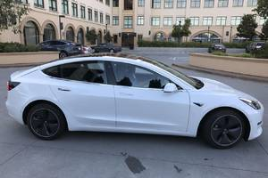 Leaked photos of the Tesla Model 3 ignite an internet power struggle