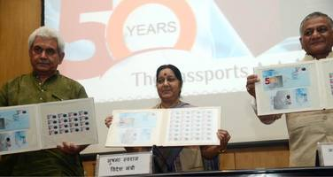 Commemorative postage stamp on completion of 50 years of Passports Act release