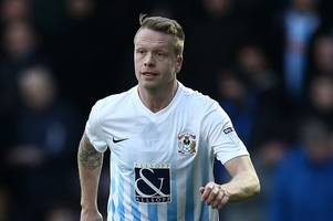 grimsby town sign former huddersfield town defender nathan clarke on a free transfer