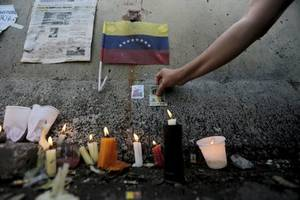 venezuelan troops open fire on protesters, killing one and raising death toll to 76
