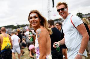 thousands of revellers descend on worthy farm for second day of glastonbury festival as radiohead headline friday night