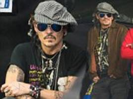 Johnny Depp spotted at the Pyramid Stage watching Corbyn