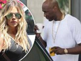 lamar odom is seen with glass of orange juice in florida