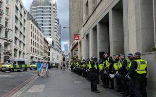 police pack into the city as strict measures imposed on london protests
