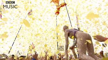 katy perry jumps into the glastonbury crowd