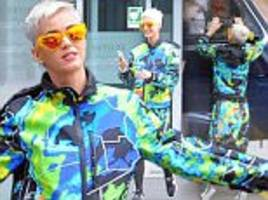 Katy Perry rocks a bright ensemble for helicopter ride