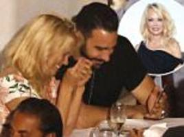 Pamela Anderson cosies up with French footballer Adil Rami