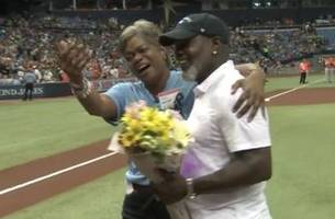 Cancer survivor Marsha Smith-Hill throws out first pitch, gets surprise visit from brother Emmitt Smith