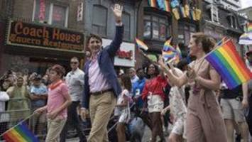 'happy pride!': prime minister justin trudeau marches in toronto pride parade for second straight year as police officers told to stay away