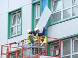 workers strip buildings after 60 buildings fail fire tests