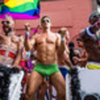 photos: nyc's massive lgbtq pride parade mixes party and protest