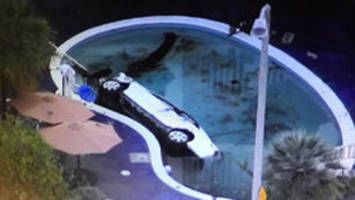 man injures 8 after driving into motel swimming pool