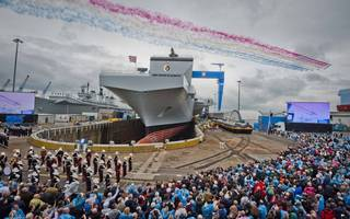 photos: britain's largest ever warship is due to set sail today